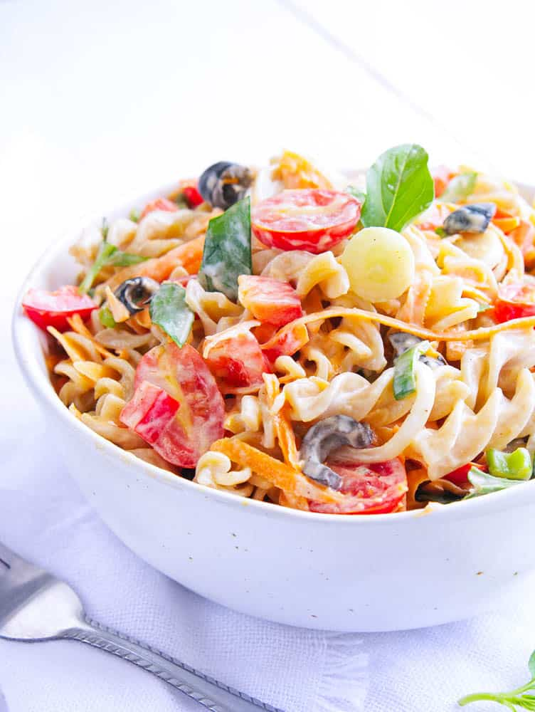 Pasta Salad with Olives and Herbs in a white bowl