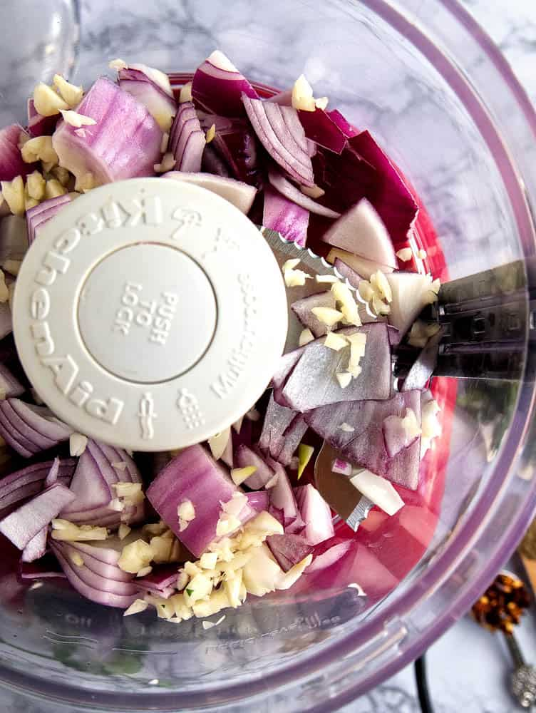Red onion and garlic in a food processor