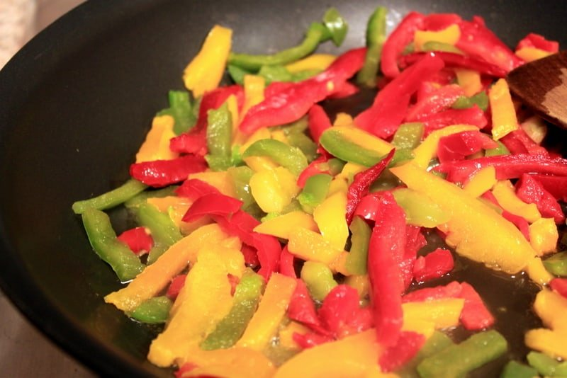 Peppers being cooked in a frying pan