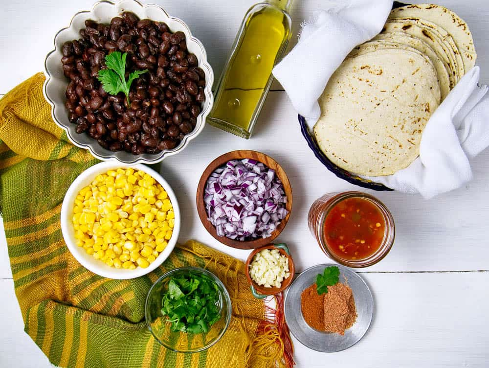 Ingredients for black bean mexican flautas displayed on white background
