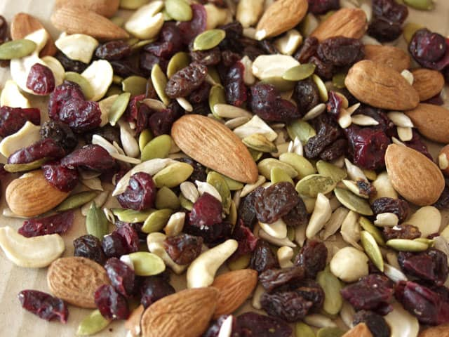 raw healthy trail mix, healthy plane snacks, with almonds, cashews, pumpkin seeds, and dried fruit