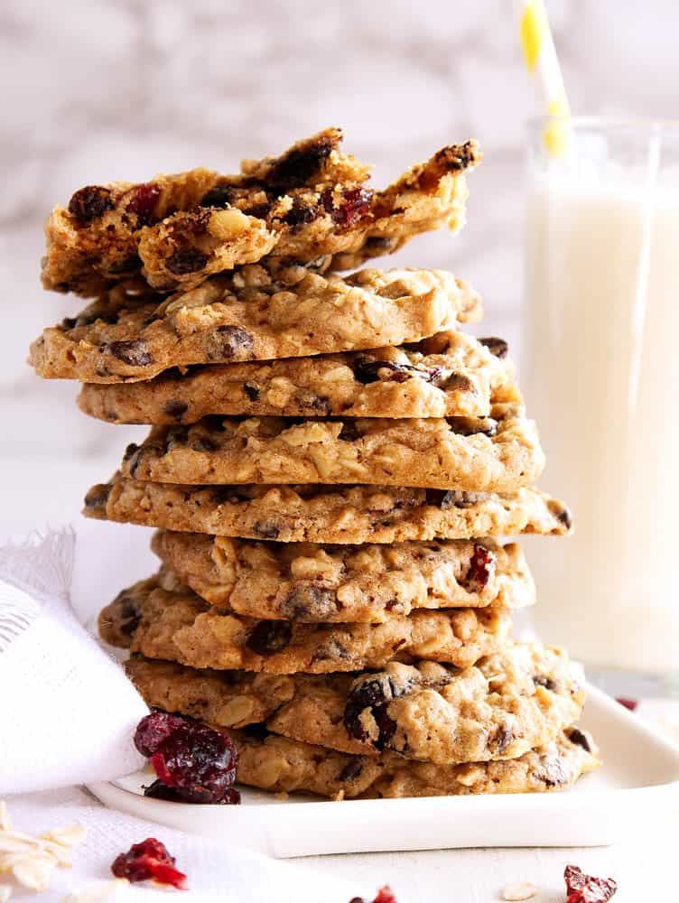 Baked Vegan Oatmeal Chocolate Chip Cookies with Cherries stacked on top of each other