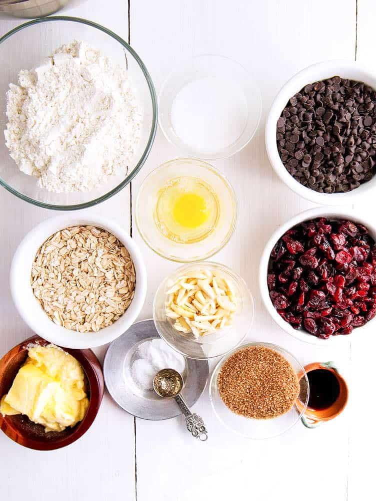 The ingredients for chocolate chip oatmeal cookies on a work surface