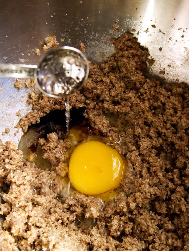 Extract and egg being added to the sugar mixture.
