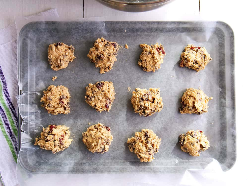 Top shot of raw chocolate chip oatmeal balls on a baking tray.