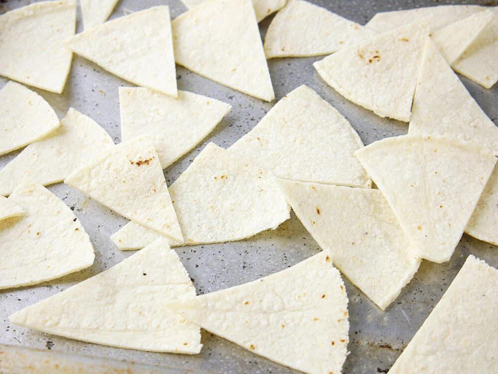 corn tortilla triangles ready to be baked in the oven