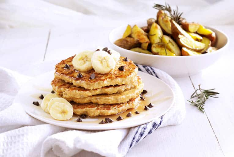 Oatmeal sunflower pancakes with banana slices on a plate