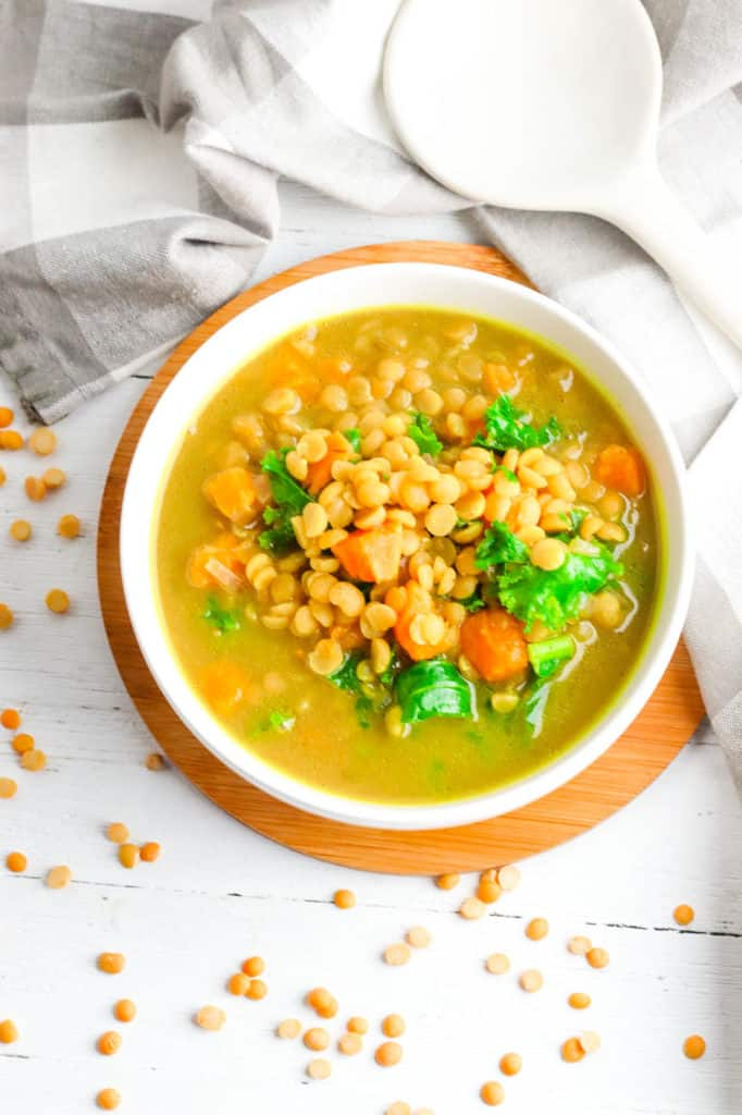sweet potato dahl with kale served in a white bowl