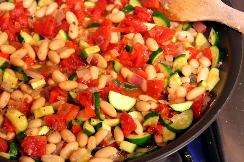 Beans and veggies in a frying pan