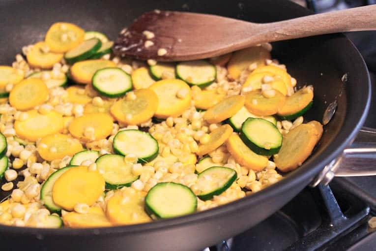 Corn and summer squash in a frying pan