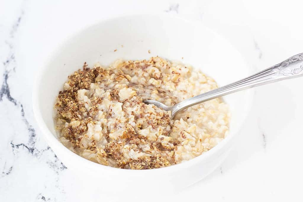 oats mixed with flax in a bowl