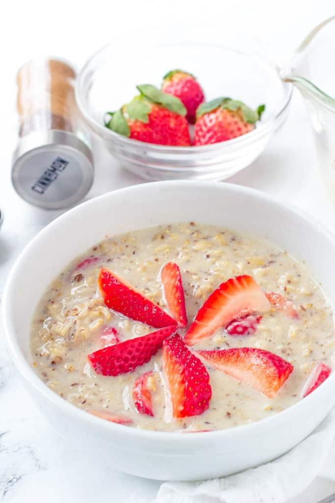 strawberries and cream oatmeal, strawberry oatmeal in a white bowl