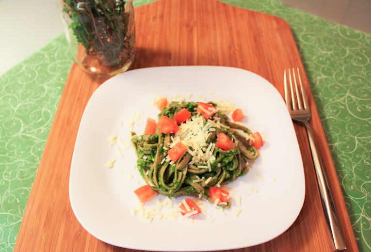Whole Wheat Linguine with Spinach Herb Pesto on a white plate with a fork
