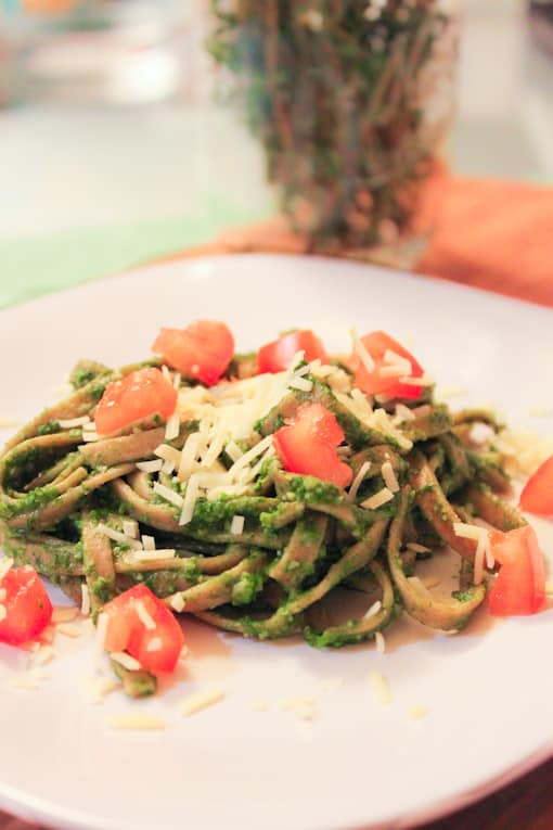 Close up of Whole Wheat Linguine with Spinach Herb Pesto served on a white plate