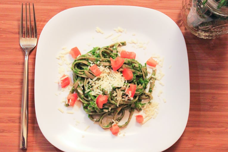 Whole Wheat Linguine with Spinach Herb Pesto served on a square white plate
