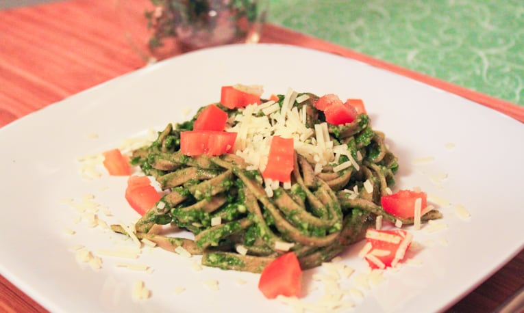 Whole Wheat Linguine with Spinach Herb Pesto served on a white plate.