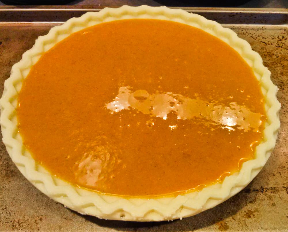 pumpkin mixture in the unbaked pie crust