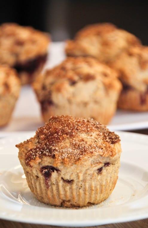 A cinnamon sugar muffin on a small white plate
