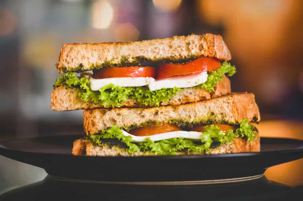 lunchbox makeover: vegetarian sandwich on sprouted wheat bread with tomatoes, cheese and lettuce