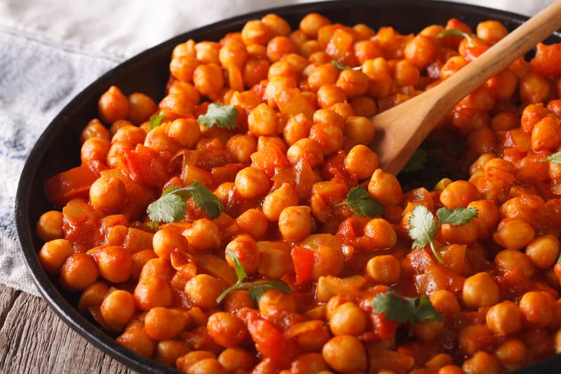 vegan chana masala recipe, served in a black bowl.