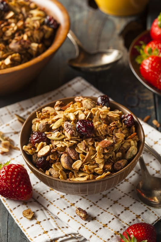 Maple Granola served in a bowl with fresh berries