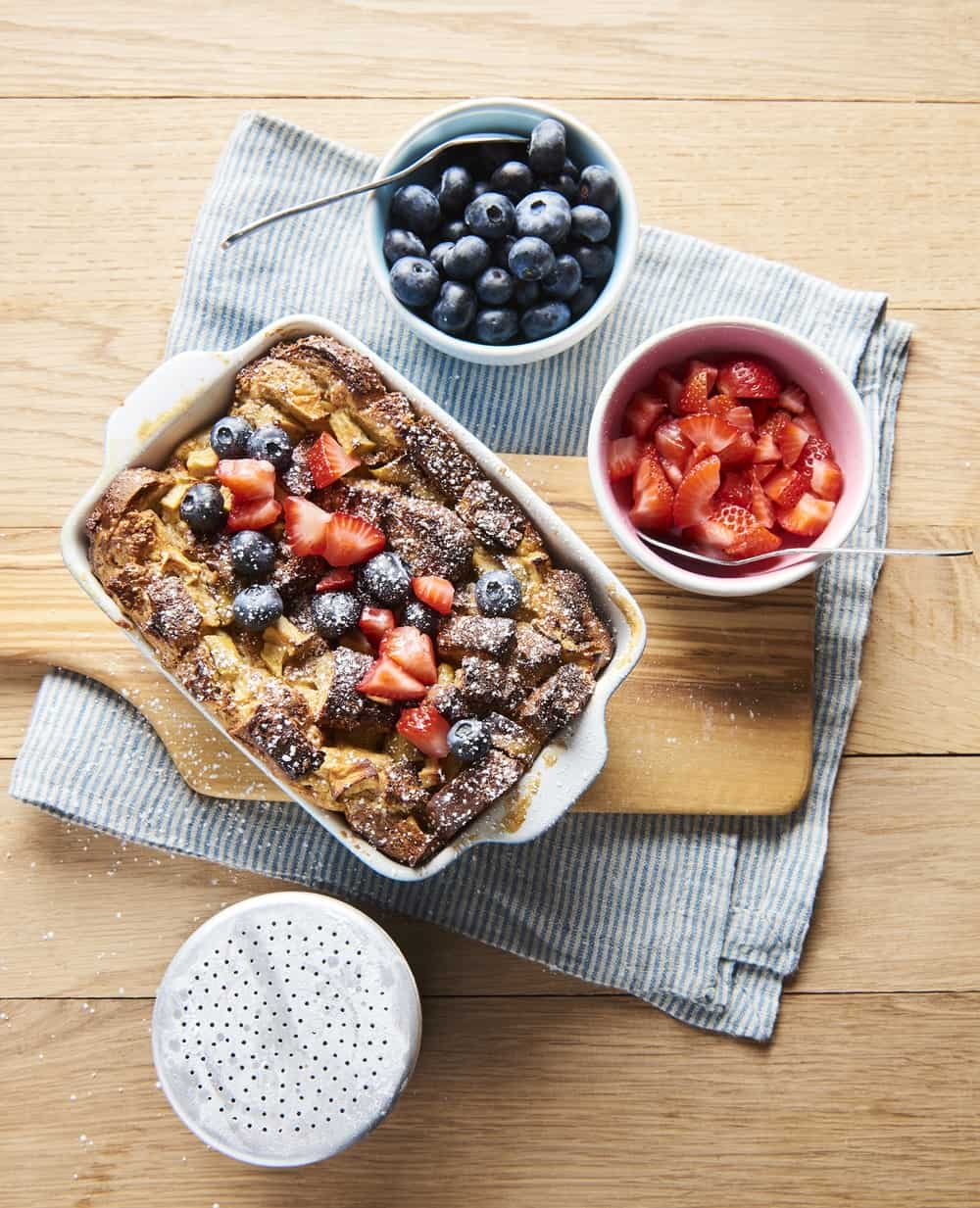 french toast bread pudding served with fresh berries, top view
