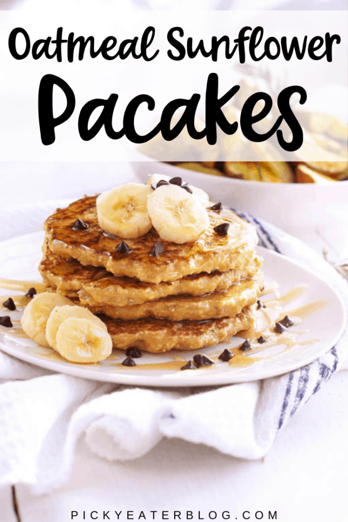 These oatmeal sunflower pancakes, topped with bananas, nut butter, maple syrup and chocolate chips are so delicious, you won't believe they're healthy too!