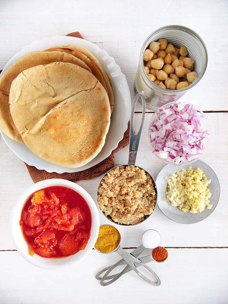 Ingredients for Curry Pizza with Chickpeas and Quinoa: chickpeas, onions, quinoa, garlic, ginger, tomatoes, spices