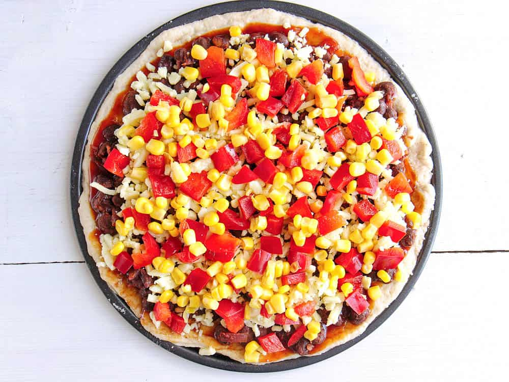 Cheese, pepper and corn put on top of the beans and bbq sauce