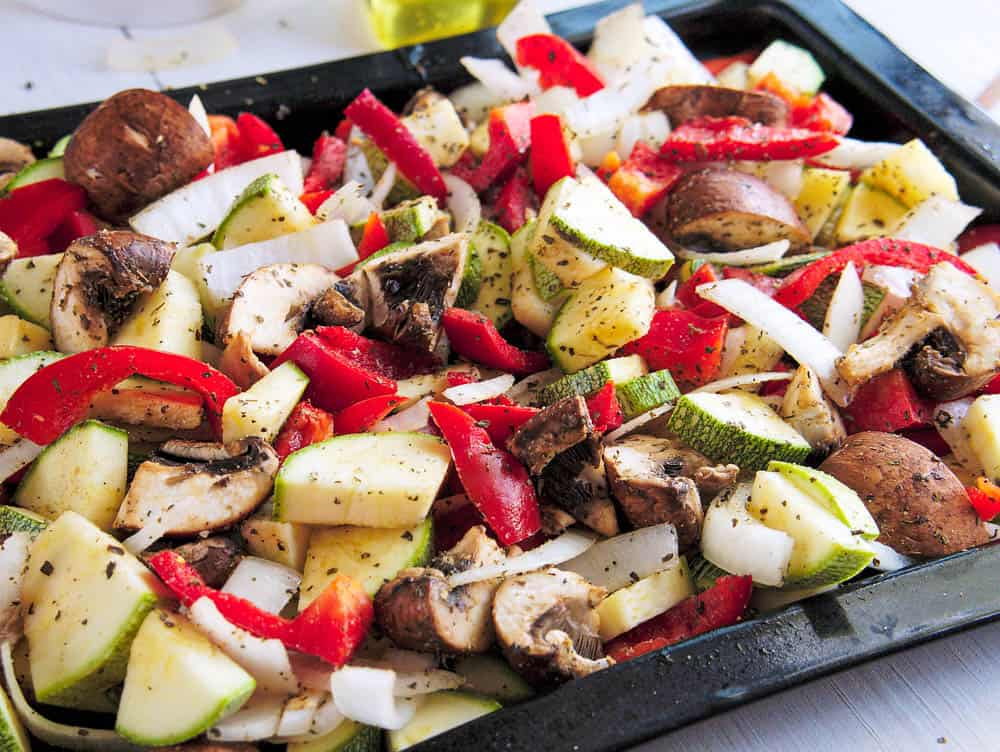 roasted Vegetables - squash, zucchini, mushrooms, onions, peppers - on a baking tray