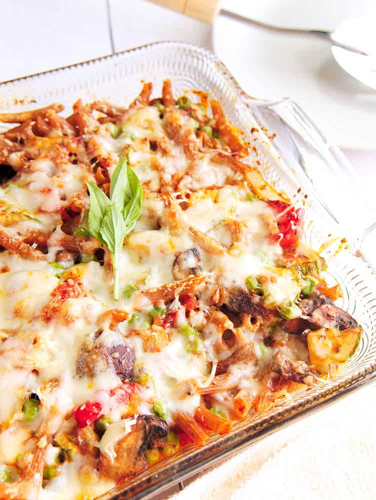 Top shot of baked penne pasta in a glass casserole dish