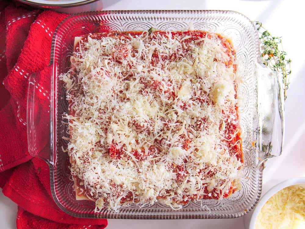 Parmesan grated on top of the unbaked healthy veggie lasagna