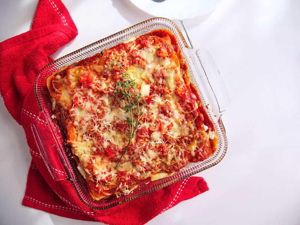 Baked healthy veggie lasagna in a glass casserole