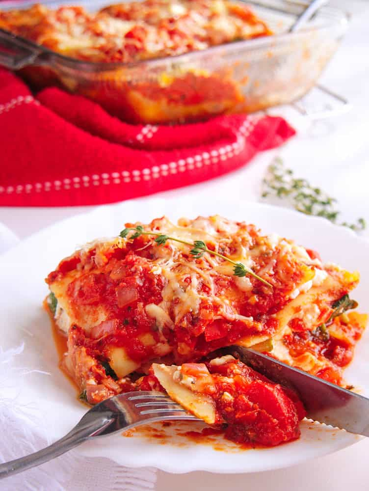 Healthy veggie lasagna served on a white plate