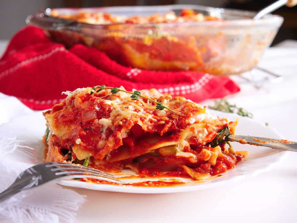 Side view of healthy veggie lasagna served on a plate