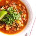 Top shot of vegetarian pozole in a white bowl