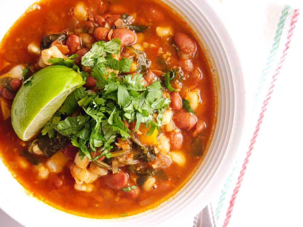 Top shot of Instant Pot Pinto Beans Vegan Posole in a white bowl