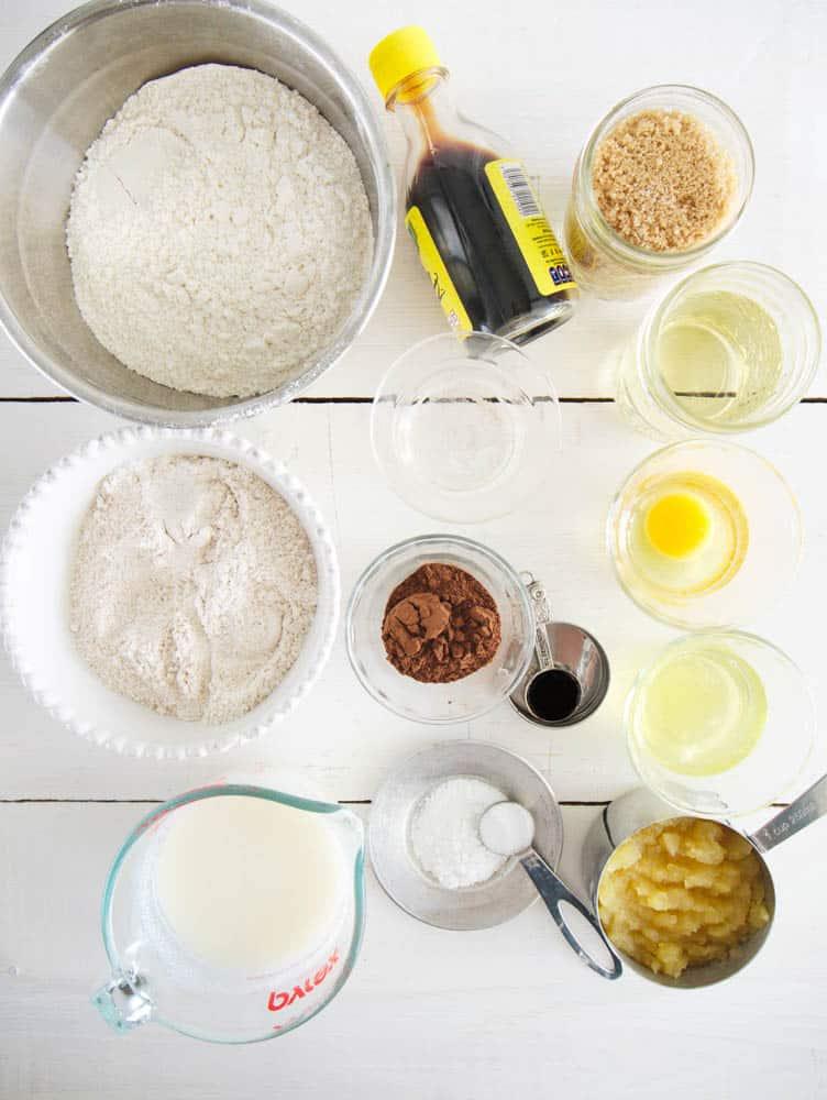 ingredients for red velvet cupcakes (flour, sugar, vanilla, etc.) on a white background