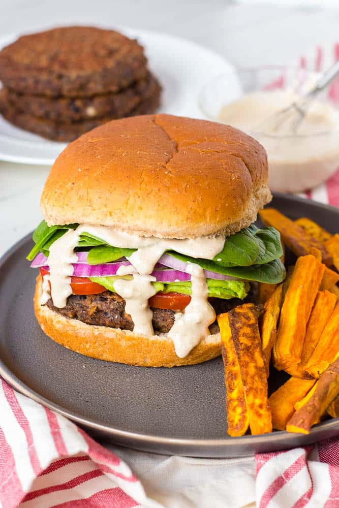 A black bean burger served with sweet potato fries