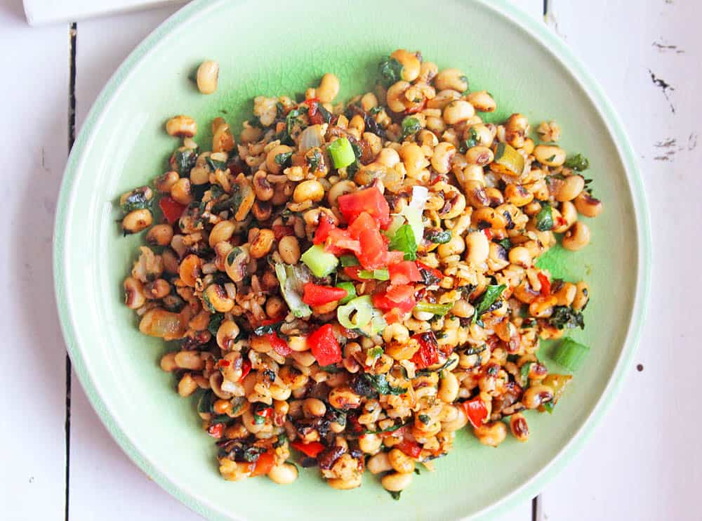 vegetarian black eyed peas recipe served on a plate with green onions