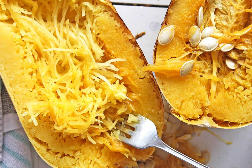 Cooked spaghetti squash being shredded