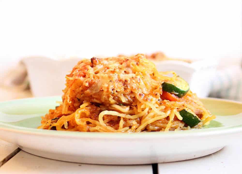 Spaghetti squash casserole served on a white plate