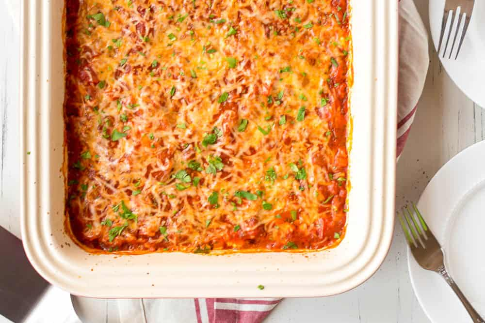 Low carb zucchini lasagna in a white casserole dish