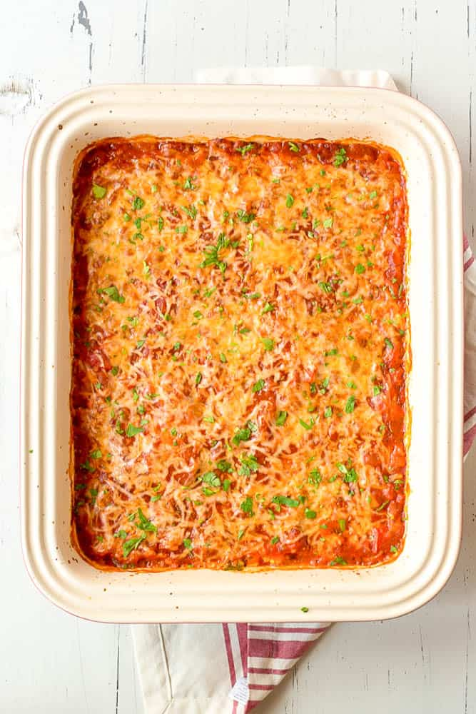 Finished baked dish with fresh herbs sprinkled on top