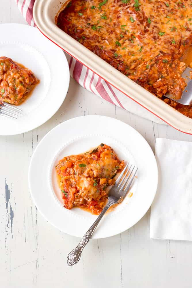 Low carb vegetarian zucchini lasagna serve on white plates with forks
