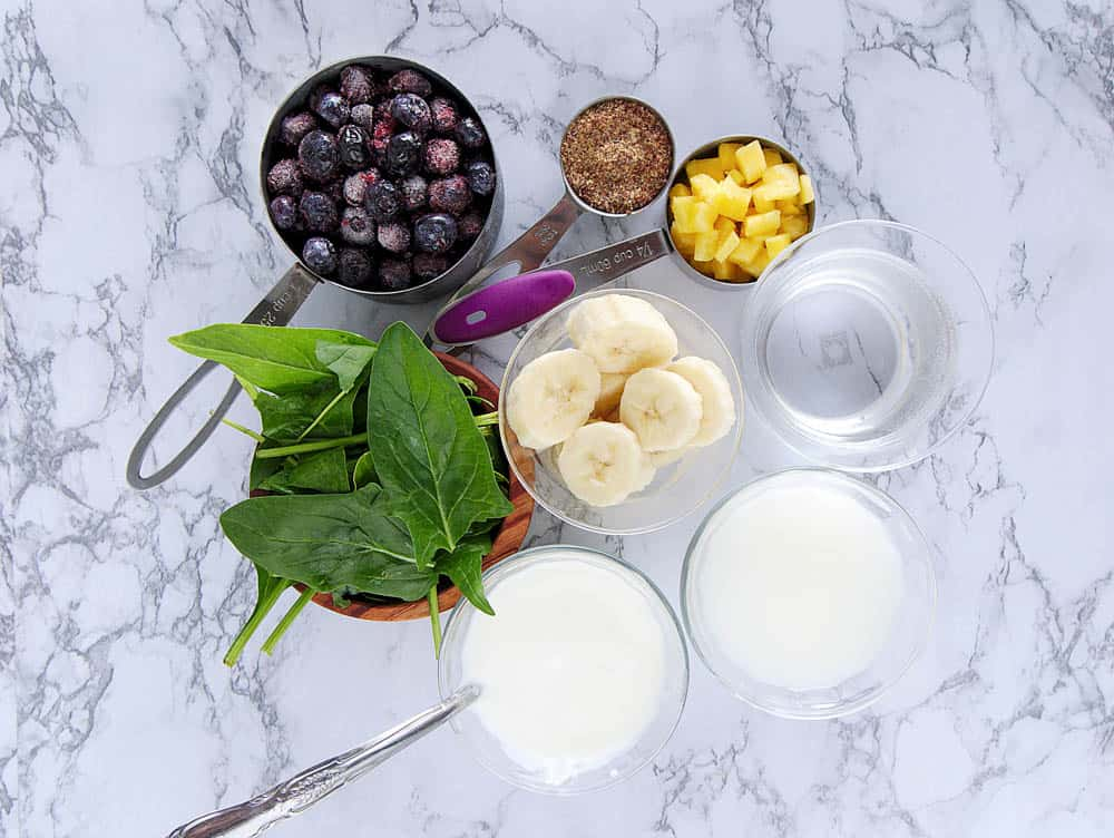 Ingredients to make a blueberry banana smoothie