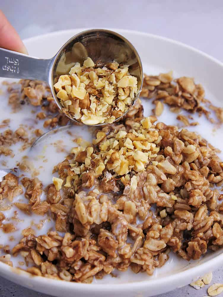 Walnuts being added to the chocolate oatmeal
