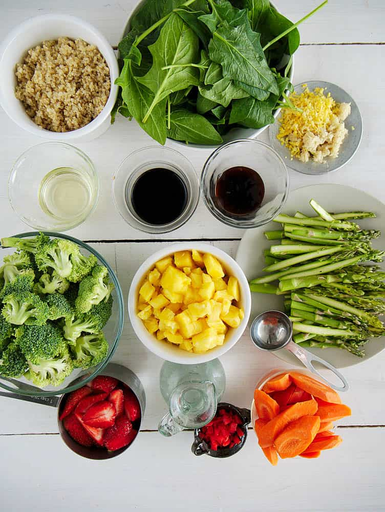 Ingredients to make the healthy vegetable stir fry sauce tossed with veggies & tofu: spinach, asparagus, broccoli, pineapple, carrots, quinoa, spices
