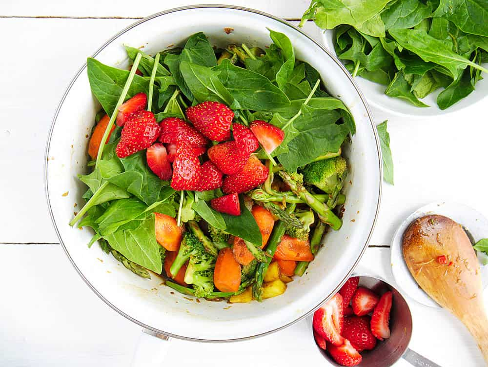 Strawberries and spinach added to the healthy vegetable stir fry sauce