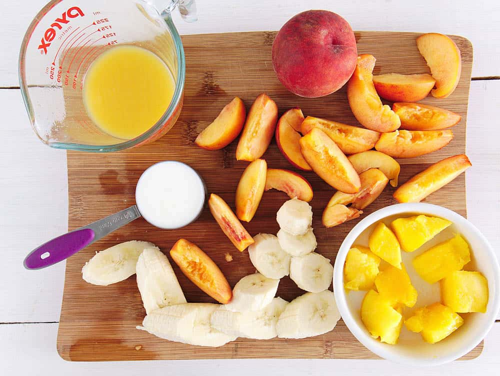 Ingredients to make a banana peach smoothie